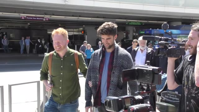 INTERVIEW Jesse Tyler Ferguson Jason Mikita talk about if there will be more gay interest mainstream films while arriving at LAX Airport in Los...