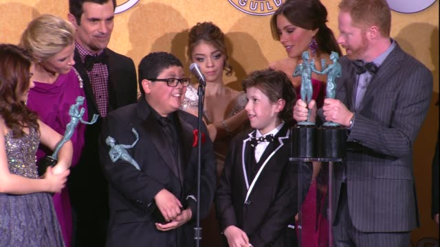 Jesse Tyler Ferguson Rico Rodriguez Nolan Gould on working with each other at 18th Annual Screen Actors Guild Awards Press Room on 1/29/12 in Los...