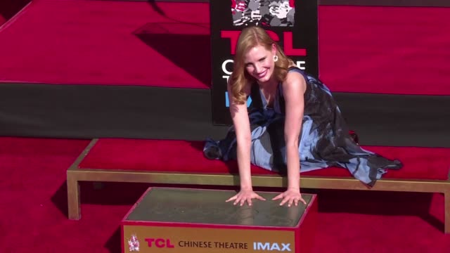 Jessica Chastain follows in the steps of her idol Elizabeth Taylor by sinking her hands and feet into cement at Hollywoods TCL Chinese Theatre...