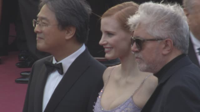 Jessica Chastain Park Chanwook Pedro Almodovar at 'Okja' Red Carpet at Palais des Festivals on May 19 2017 in Cannes France