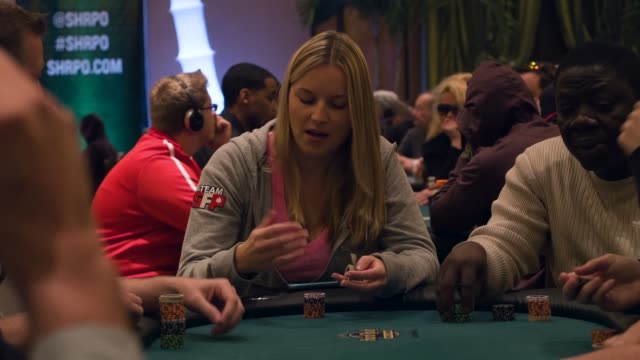 jessica dawley tosses a card during the opening day of the seminole hard rock poker showdown on march 27, 2014 in hollywood, florida. the tournament... - hollywood florida stock videos & royalty-free footage