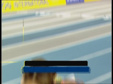 jessica ennis jumps as a guest in the women's long jump at the norwich union indoor athletics championships - lanci e salti femminile video stock e b–roll