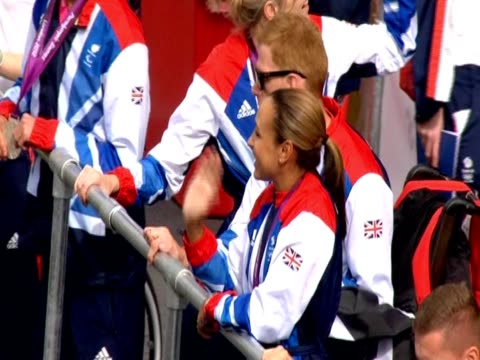Jessica Ennis waves from bus during the London 2012 Athletes parade