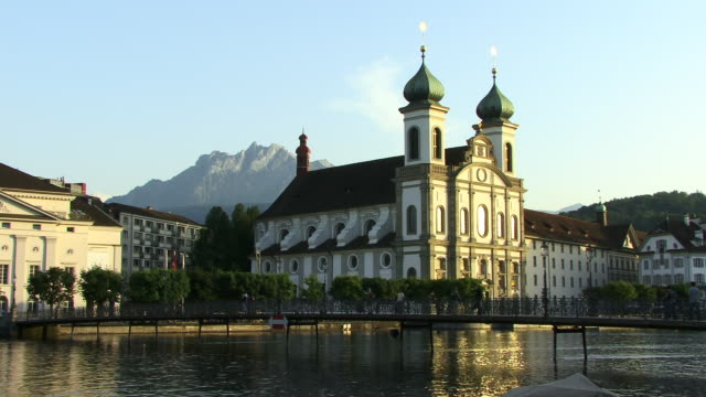 ws, jesuit church by river reuss, lucerne, switzerland - okänt kön bildbanksvideor och videomaterial från bakom kulisserna