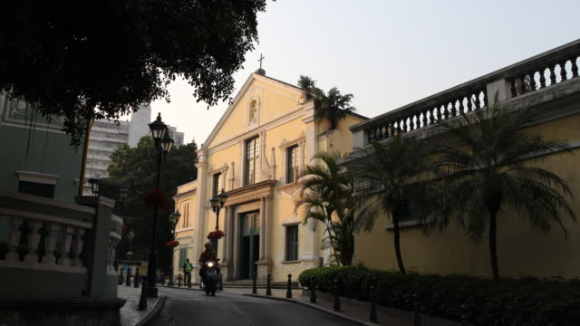 a jesuit church in colonial style at a narrow street in the historic centre of macau - jesuit stock videos and b-roll footage