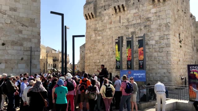 a jesuit priest talks to a german tour group at jaffa gate in the old city - jesuit stock videos and b-roll footage