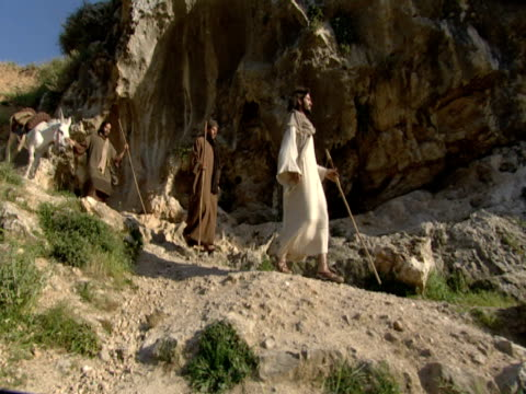 Jesus and his disciples descend Mount Zion.