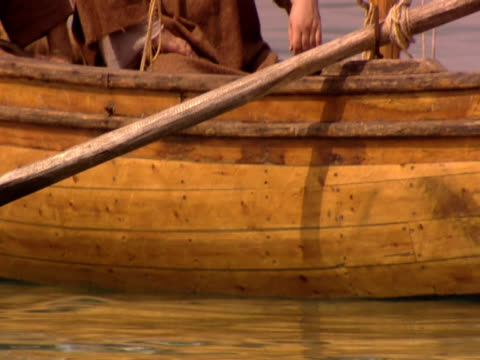 stockvideo's en b-roll-footage met jesus and his disciples in a fishing boat on the sea of galilee. - mid volwassen mannen