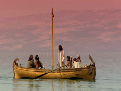 stockvideo's en b-roll-footage met jesus and his disciples stand in a fishing boat on the sea of galilee. - mid volwassen mannen
