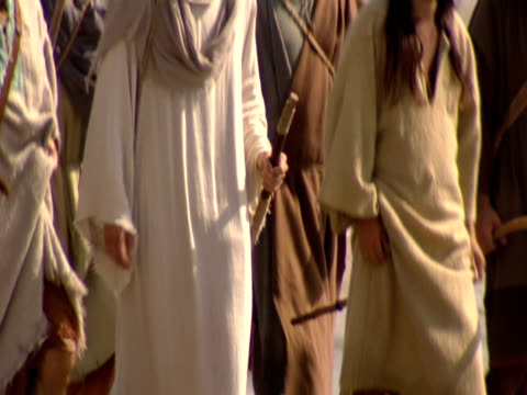 stockvideo's en b-roll-footage met jesus and his disciples walking along beach by sea of galilee. - mid volwassen mannen