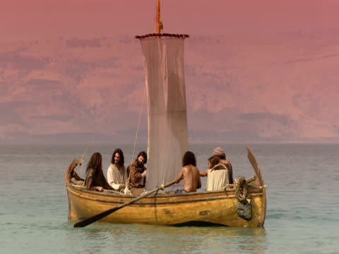 Jesus and the disciples sail across the Sea of Galilee.