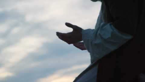 jesus christ kneels on the ground and prays with palms out outdoors at sunset - judaism stock videos & royalty-free footage