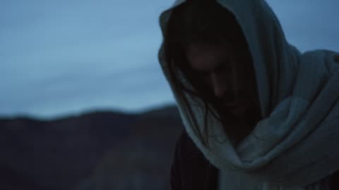 jesus christ kneels prays outdoors at sunrise/sunset outdoors - christianity stock videos & royalty-free footage