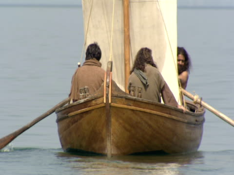 stockvideo's en b-roll-footage met jesus crossing sea of galilee in rowing boat with disciples - mid volwassen mannen