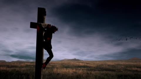 jesus crucifixion video loop - kors religiös symbol bildbanksvideor och videomaterial från bakom kulisserna