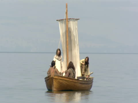 stockvideo's en b-roll-footage met jesus on baot with disciples on the sea of galilee - mid volwassen mannen