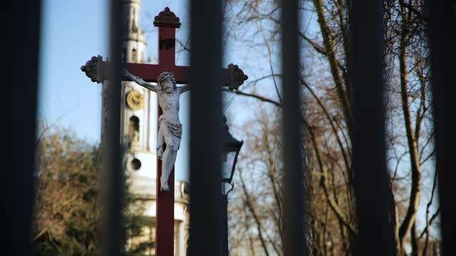 jesus on cross statue outside church in deptford, london - male likeness stock videos & royalty-free footage