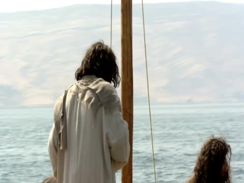 jesus on fishing boat with disciples on sea of galilee. - apostel bildbanksvideor och videomaterial från bakom kulisserna