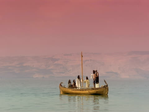 stockvideo's en b-roll-footage met jesus with his disciples in a fishing boat on the sea of galilee. - mid volwassen mannen