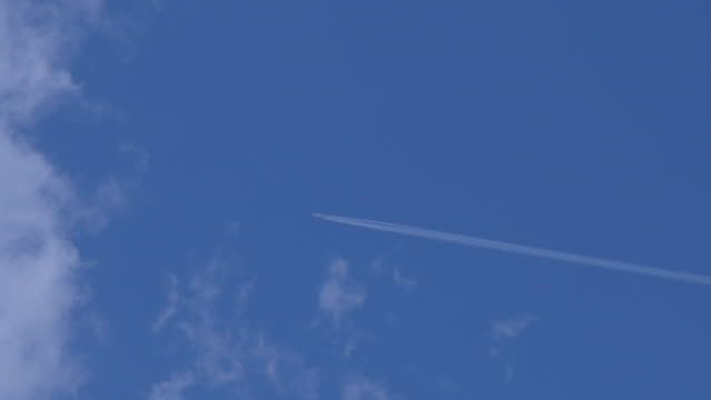 ws of jet aircraft cruising in sky - vapour trail stock videos & royalty-free footage