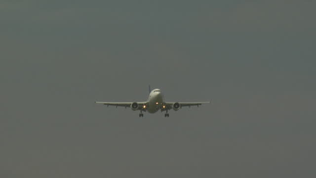 Jet aircraft on approach to land with landing gear down
