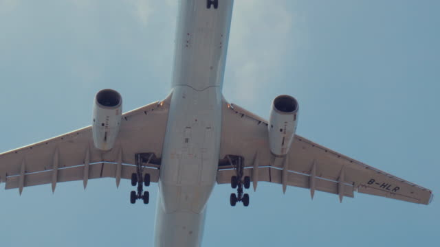 jet airplane flying overhead - landing touching down stock videos & royalty-free footage