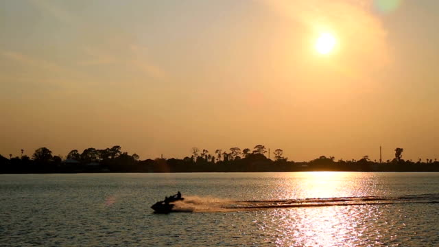 Jet Boat in the river at sunset