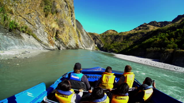jet boat ride shotover river queenstown new zealand - queenstown stock videos & royalty-free footage
