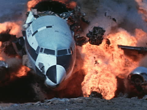 a jet crashes into a hillside and explodes. - incidente aereo video stock e b–roll