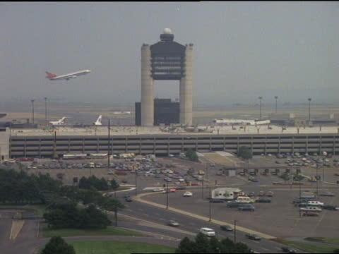 a jet departs from logan international airport. - boston massachusetts stock videos & royalty-free footage