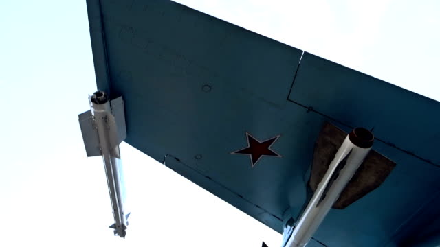 Jet fighter wing with missiles underneath