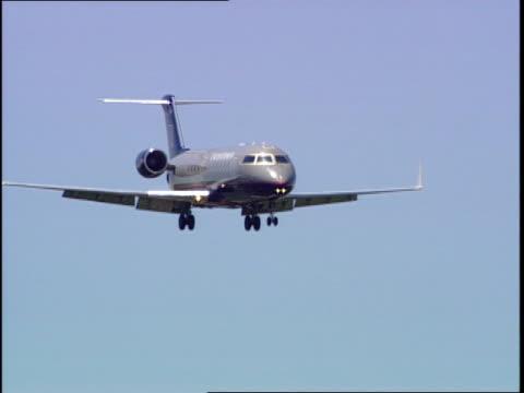a jet flies with landing gear down - landefahrwerk stock-videos und b-roll-filmmaterial