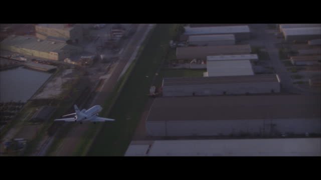 air to air, jet landing on runway and taking off - air to air shot stock videos and b-roll footage
