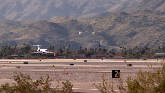 WS TS Jet landing on runway at international airport / Palm Springs, California, USA