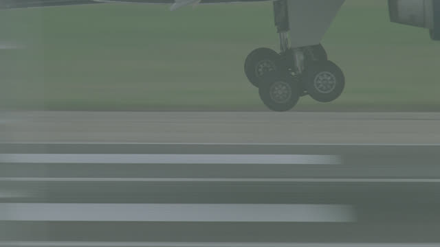 cu n-d jet landing; view of lower 1/2 of jet wheels touching down; no markings visible - landing touching down stock videos & royalty-free footage