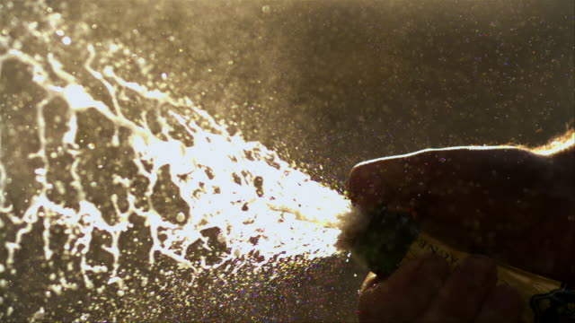 jet of champagne erupting from a bottle - 6000fps (240x slowed down) - spraying stock videos and b-roll footage