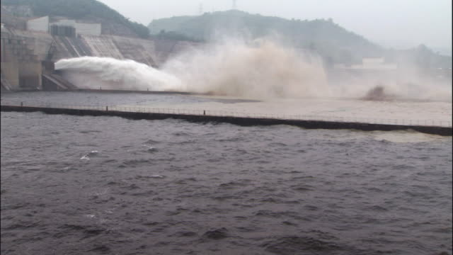 jet of water spurting from xioalangdi dam - hydroelectric power stock videos & royalty-free footage