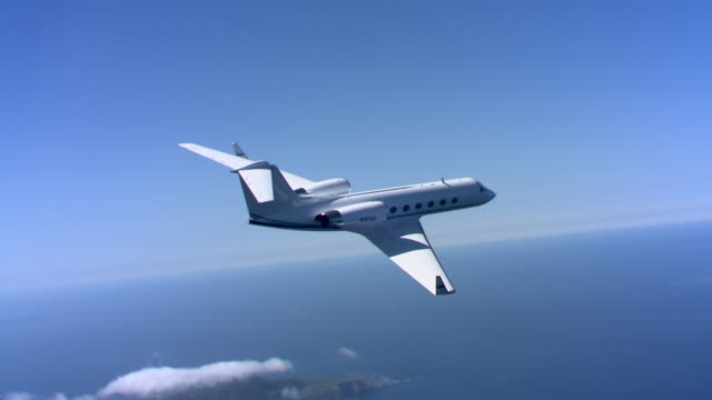 jet over islands - private jet stock videos & royalty-free footage