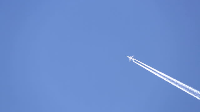 jet plane in the sky. - passagierflugzeug stock-videos und b-roll-filmmaterial