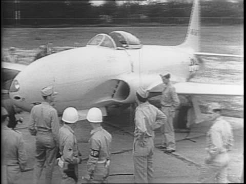 P80 jet plane parked on tarmac / view of plane on tarmac without a propellor / closer view on of the jet place without its propellor and men with...