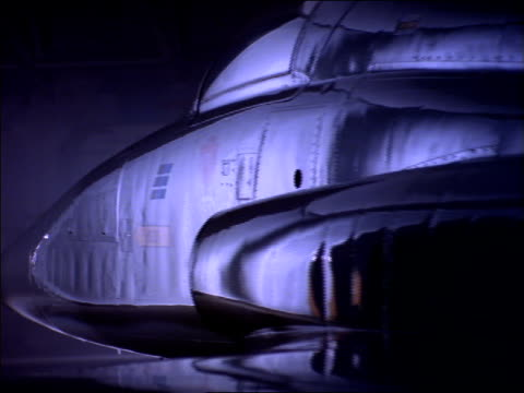 a jet sits in a hangar. - hangar stock-videos und b-roll-filmmaterial