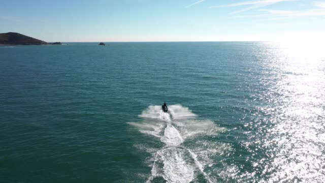 jet ski aerial chase - channel islands england stock videos & royalty-free footage
