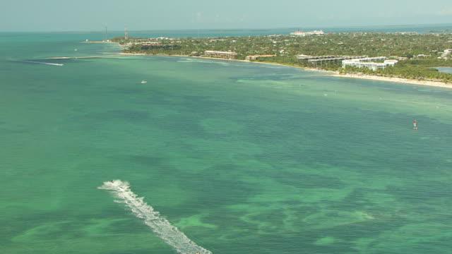 ms aerial jet ski posse moving along key west coast / key west, florida, united states - key west stock videos & royalty-free footage