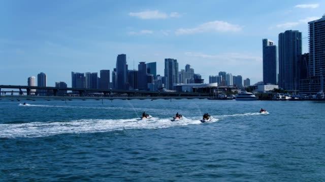 jet ski tour downtown miami - acquascooter video stock e b–roll