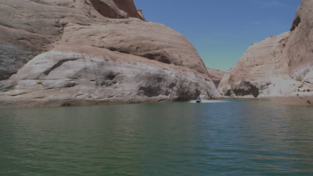 ws pan jet skier driving by powell lake / page, neveda, united states - lake powell stock videos & royalty-free footage