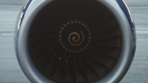 jet turbine on grounded plane - turbine stock videos & royalty-free footage