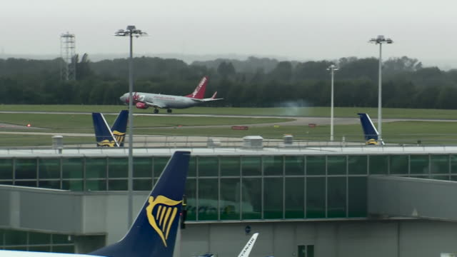 jet2 holidays plane arriving back from ibiza at stansted airport as the uk government impose two week quarantine on people travelling back from spain... - moving down stock videos & royalty-free footage
