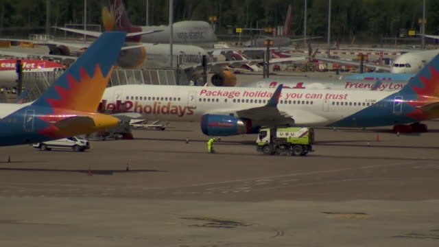 jet2 holidays planes at stansted airport filmed during coronavirus pandemic - reportage stock videos & royalty-free footage