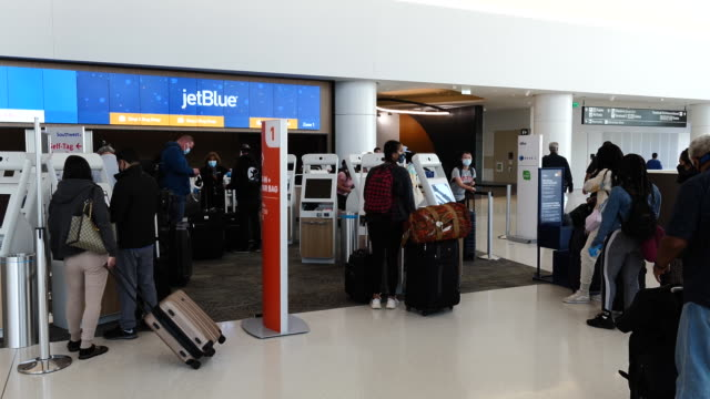 jetblue airways check-in counters at san francisco international airport in san francisco, california, u.s., on wednesday, july 15, 2020. - san francisco international airport stock videos & royalty-free footage