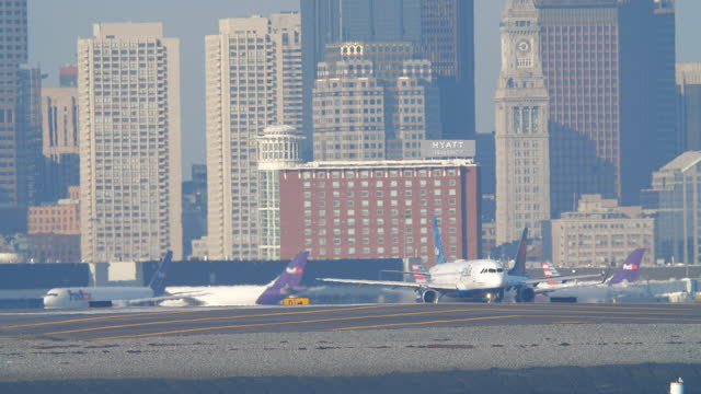 jetblue, fedex and delta planes taxiing in boston logan international airport - animal call stock videos & royalty-free footage